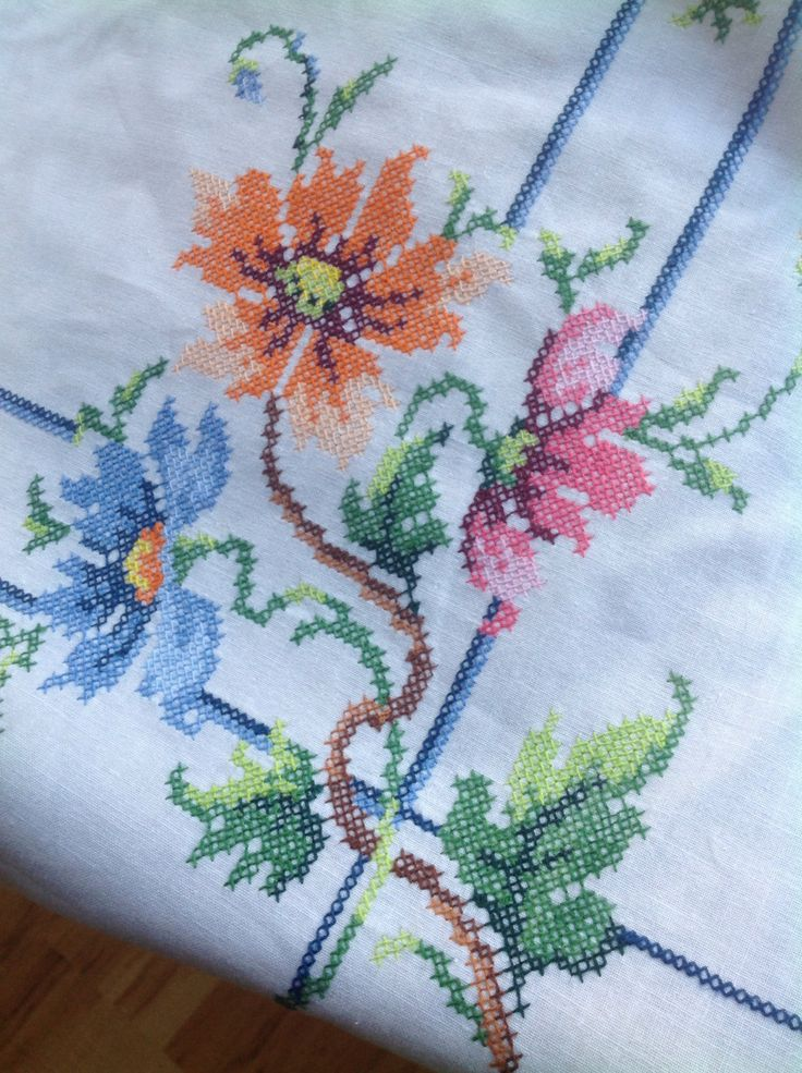 Stunning white cotton table cloth beautifully embroidered with flowers and a blue border floral pink green red blue cross stitch pretty by ReworkedHomewares on Etsy