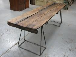 Recycled timber dining tables hand made by Neel Dey black thin trestle base