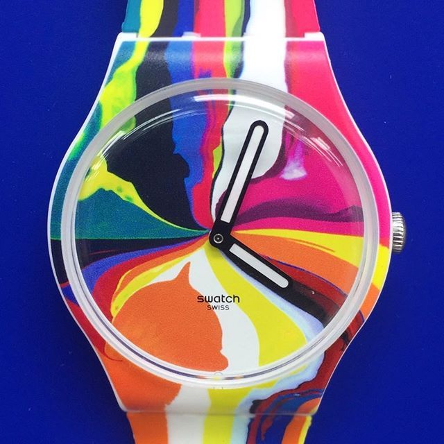 Designing the limited edition (1,966 pieces) Swatch Art Special watch, WIDE ACRES OF TIME, the smallest canvas painted on to date where paint pours and swirls into a vortex of colour #iandavenport #swatchxbiennalearte #watch #swatch #design #accessories #collection #limitededition #swirls #stripes #colour #time #vortex #timeless #colourful #fashion #lifestyle #clock