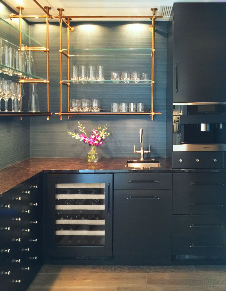 Open concept kitchen shelves. Brass pipe-like shelves make this a classic yet modern kitchen.