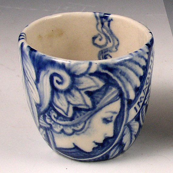 by PSPorcelain.....a little blue and white porcelain cup with faces...etsy