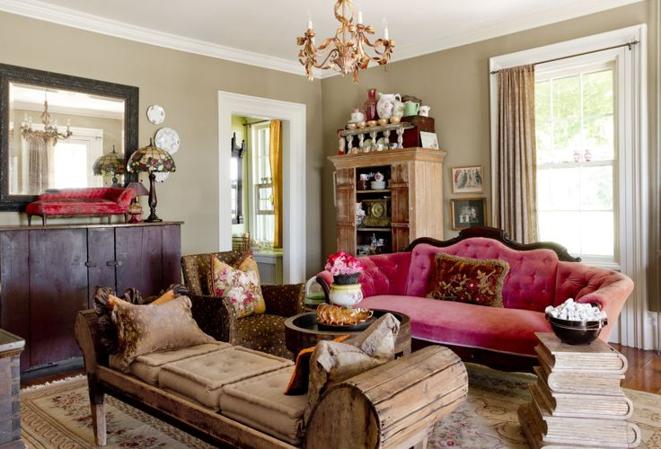While many of this home's antique finds are more rustic looking, the Victorian couch really makes a statement in the sitting room. Amanda upholstered it with pink velvet, adding a splash of luxury to the country home.