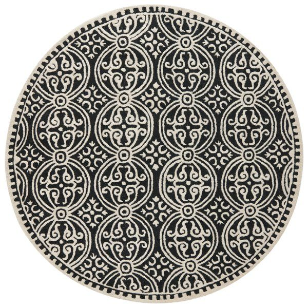 Featuring an intricate geometric design, this monochrome wool rug is the perfect anchor for your traditional living room or exotic loft.