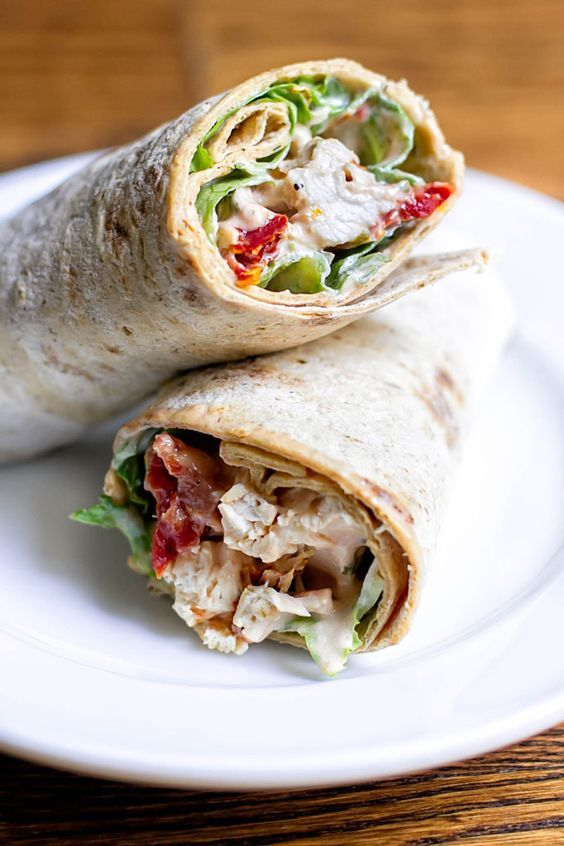Creamy sun-dried tomato chicken salad made with grilled chicken, sun-dried tomatoes, capers and all wrapped up with lettuce in whole grain wrap.