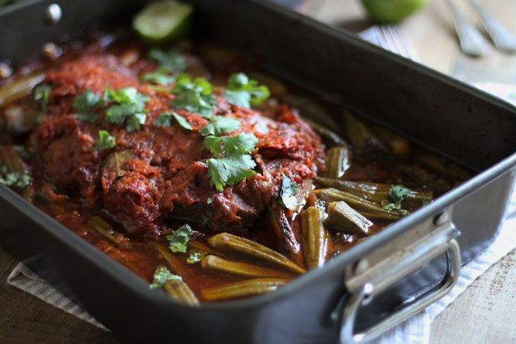 Egyptian okra stew 'Bamya' cooked with a lamb shoulder in a spicy tomato broth. Featured in Netflight magazine.