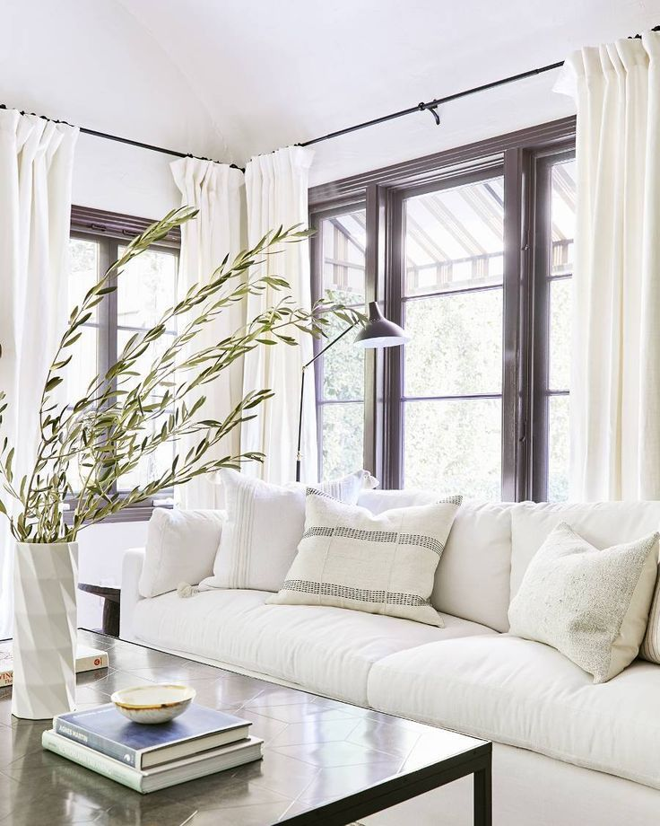 A 1920s Spanish Style Bungalow Gets A 120k Makeover Step Inside Living Room Decor Neutral Minimalist Living Room Decor Minimalist Living Room
