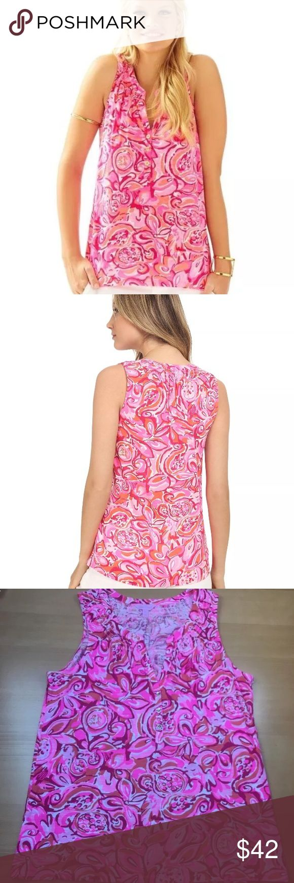 Lilly Pulitzer NWOT Essie Pink Pout Mango Salsa SLEEVELESS ESSIE TOP DESCRIPTION  Love the effortless fit of Elsa? Say hello to Essie! The Essie top is a sleeveless printed top with smocking around the neckline. Wear this cotton tank with white denim and wedges.  Sleeveless Top With Center Front Placket With Gold Button Detail And Smocking Around Neckline. Slubby Cotton Jersey- Printed (100% Cotton). Machine Wash Cold, Delicate Cycle. Imported. Style #: 97864 Lilly Pulitzer Tops Tank Tops