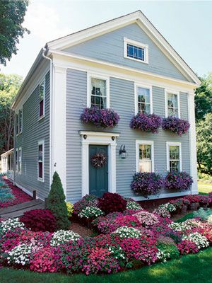 Overflowing with your favorite flowers, window boxes are a fantastic and budget-friendly way to up your home's curb appeal. For dramatic effect, mix in a plant that picks up your trim color.