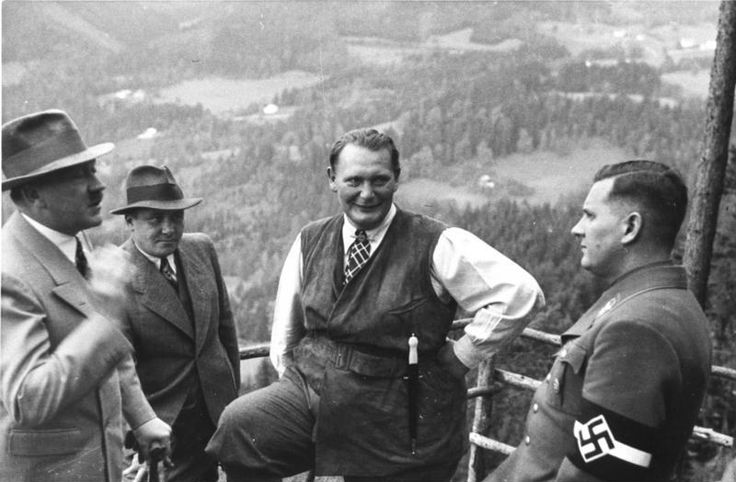 Hitler addresses Baldur von Schirach, the Hitler Youth leader (in uniform), during informal time at Hitler's mountain retreat at Obersalzberg. A jovial-looking Goering looks on, dressed in one of his usual theatrical outfits complete with ceremonial dagger. The other onlooker is Martin Bormann, Hitler's sinister right-hand-man. The Leader is unusually in mufti and wearing a hat; he preferred the party uniform almost always.