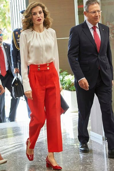 5 October 2016 - Queen Letizia attends a work meeting at Red Cross headquarters in Madrid - blouse by Hugo Boss, trousers and shoes by Uterque