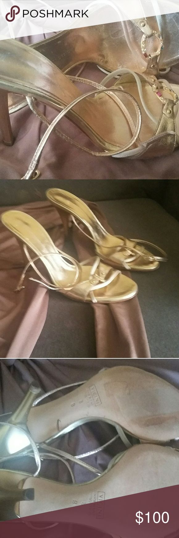 Giuseppe Zanotti rose gold heels Never been worn. Purchased from another site. Gorgeous strappy rose gold jeweled GZ Vicini shoes. 3 inch heels.  Straps are rose gold. Heel is yellow gold. All jewels are intact. Too low for me. I like at least 4 inches. Marked size 38 (8). Best for size 7.5. Not suitable for wider feet. Giuseppe Zanotti Shoes Heels