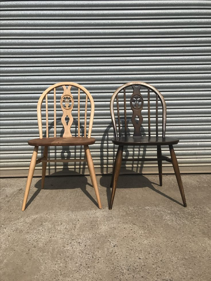 Ercol Fleur de lys dining chairs one sanded back to blonde the other vintage original colour.