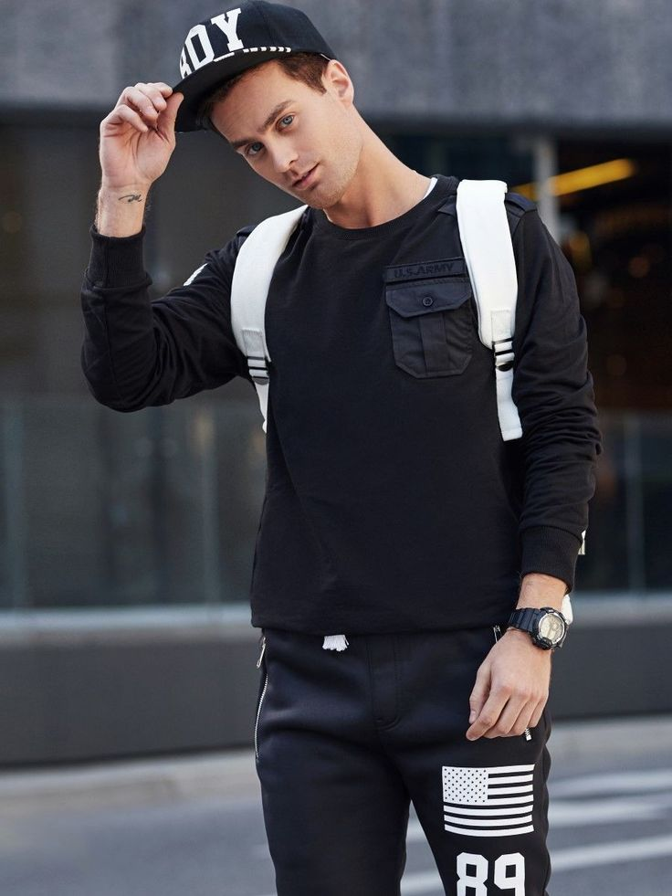 Sophisticated look from the Bolf collection in sport style. The black sweatshirt has got a fetching pocket on the front which goes well with streetwear baggy trousers with a print. To juice up the outfit a little bit, we added a stylish watch.