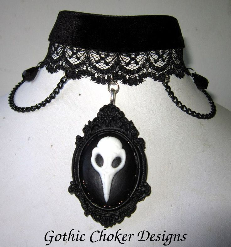 Gothic velvet and lace choker with crow skull cameo and chains.  R160 (approx $16) Purchase here:https://hellopretty.co.za/gothic-choker-designs/black-velvet-and-lace-choker-with-raven-skull-cameo