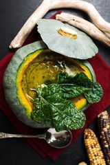 top view of black cabbage and pumpkin soup