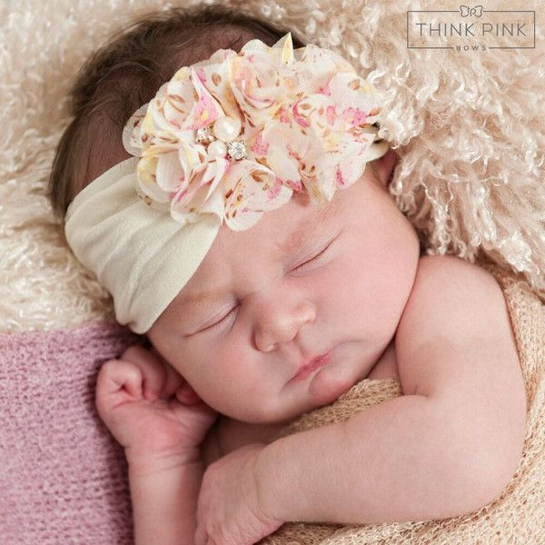 This headband is made of three petite petaled pearled flowers arranged on acomfortable elastic headband. Flowers are felt-backed for comfort. Simple and elegant. Dress it up or down! Ideal for pictures, holidays, play outfits, performances, weddings, programs, birthdays, parties, or everyday!