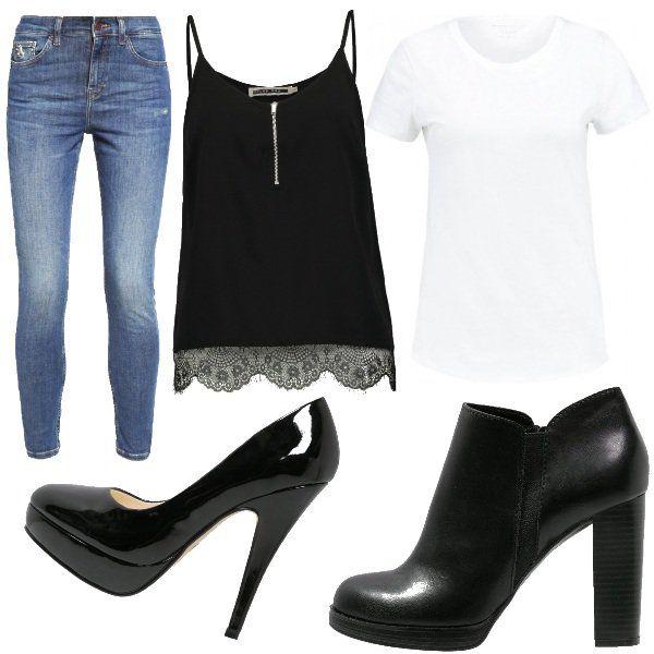 Questo+outfit+è+caratterizzato+dall'abbinamento+di+una+t-shirt+basica+bianca+con+un+top+nero+con+pizzo+sul+fondo+e+zip+(sovrapporre+un+top+a+una+t-shirt+è+molto+di+moda+questo+autunno/inverno).+Il+look+viene+completato+da+jeans+skinny+e+per+le+scarpe+ho+ben+due+proposte:+il+tronchetto+nero+con+tacco+largo+e+plateau+oppure+la+décolleté+in+vernice+con+tacco+più+fine+e+plateau.+Outfit+da+indossare+per+il+lavoro,+il+tempo+libero,+per+l'università+oppure+per+una+serata+non+troppo+impegnativa.