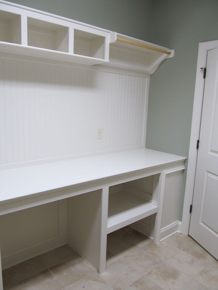 Folding station has place for laundry sorter, laundry basket, hanging area, & cubbies for decorative baskets. You can add bullitin boards, craft accessories to add personal touches.