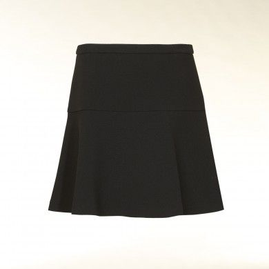 I am really in love with this one.  Looks like a half/quarter circle added to a basic skirt pattern at the hip.