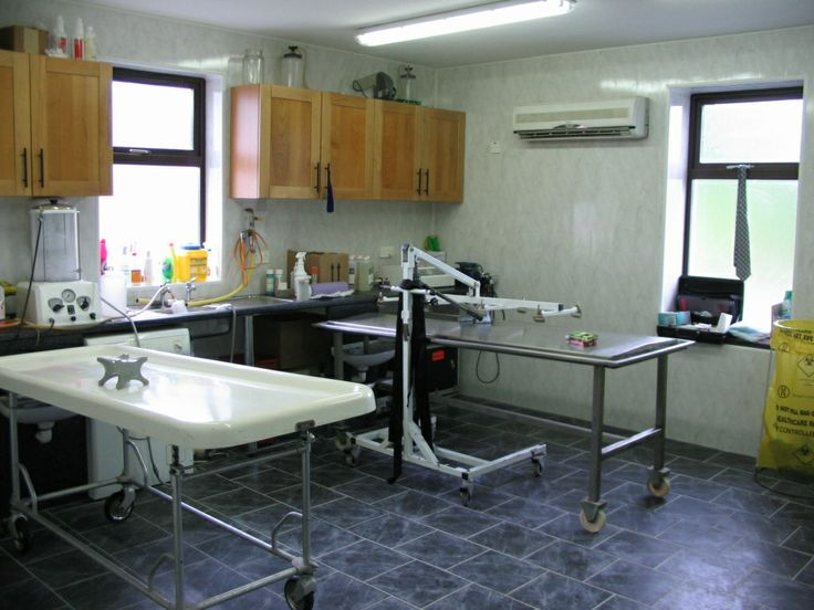Embalming room with embalming table on left dressing table Embalming room design