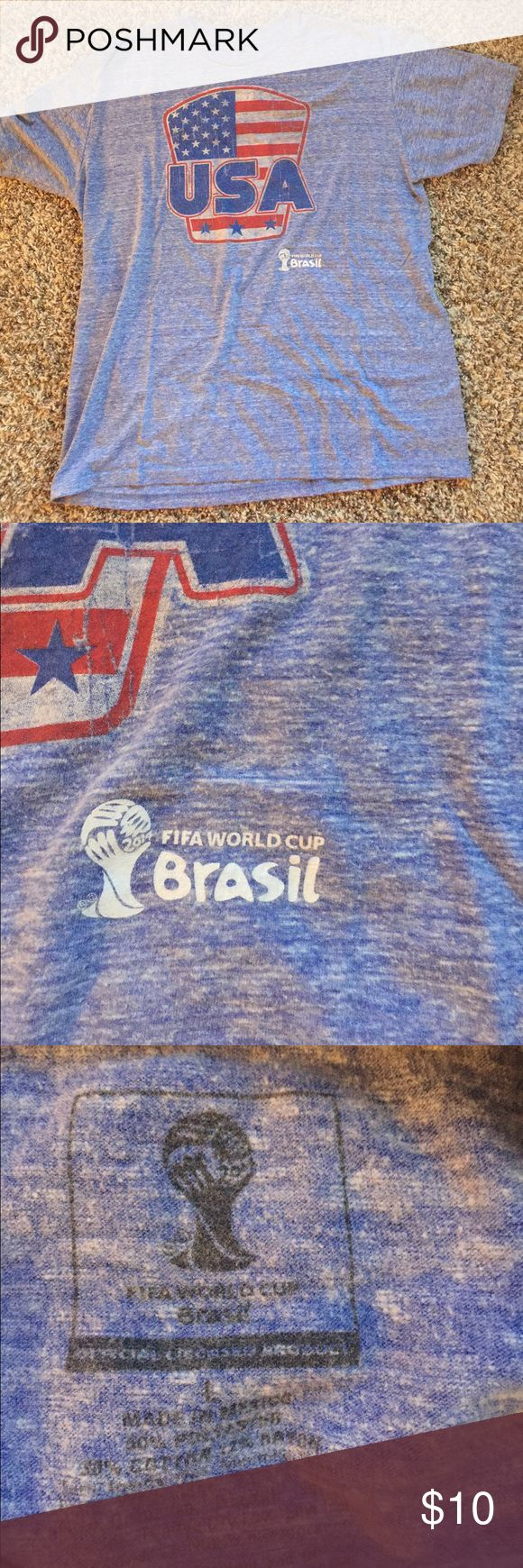 Men's USA Soccer shirt > Men's USA soccer team short sleeved shirt. 2014 Brazil FIFA Cup edition. Vintage style with light blue color and light colored details. Close up picture shows World Cup edition detail. Great condition < Shirts Tees - Short Sleeve