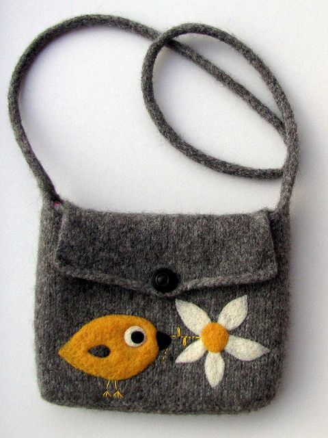 This bag was hand knitted in wool, then (washing) machine felted. The bird and flower embellishments were needle felted onto the bag.  Handmade by Mia.