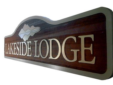 Lakeside Lodge is a resort nestled in the Wyoming Rockies. This narrow sign was designed to hug the ground surrounded by local flowers and plants. HDU was selected as the substrate because of its resistance the harsh winter weather in this area. The reflective mountain and lake motif in the company logo were incorporated in the sign design. Summer activities include camping and hiking. High lights in winter are powder snow skiing and snowmobile treks. #rusticsigns #signage #woodensigns