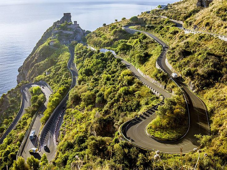 A long and winding road leads to Sicily's Sant'Alessio Castle, perched above the Ionian Sea in Messina. Nearby is the commune of Sant'Alessio Siculo, lined with beaches and old world charm. Photograph by SIME/eStock Photo, May 12, 2014