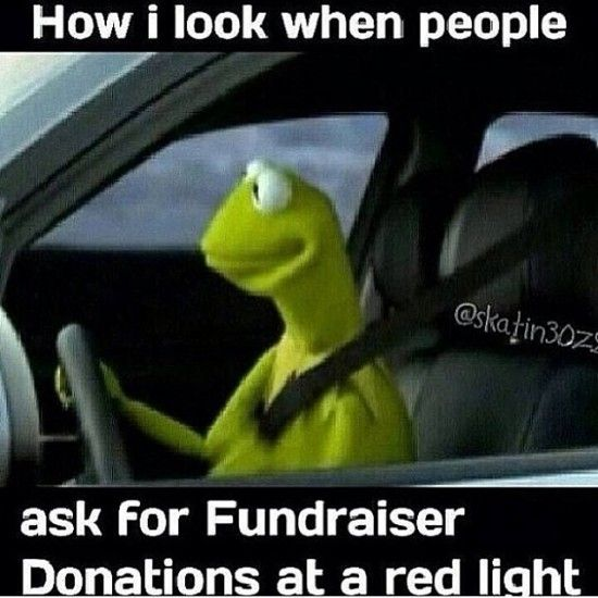 I always think they are very brave or very stupid for standing in the road to beg for money anyway.  I rarely feel safe IN a car much less out of one on the road.