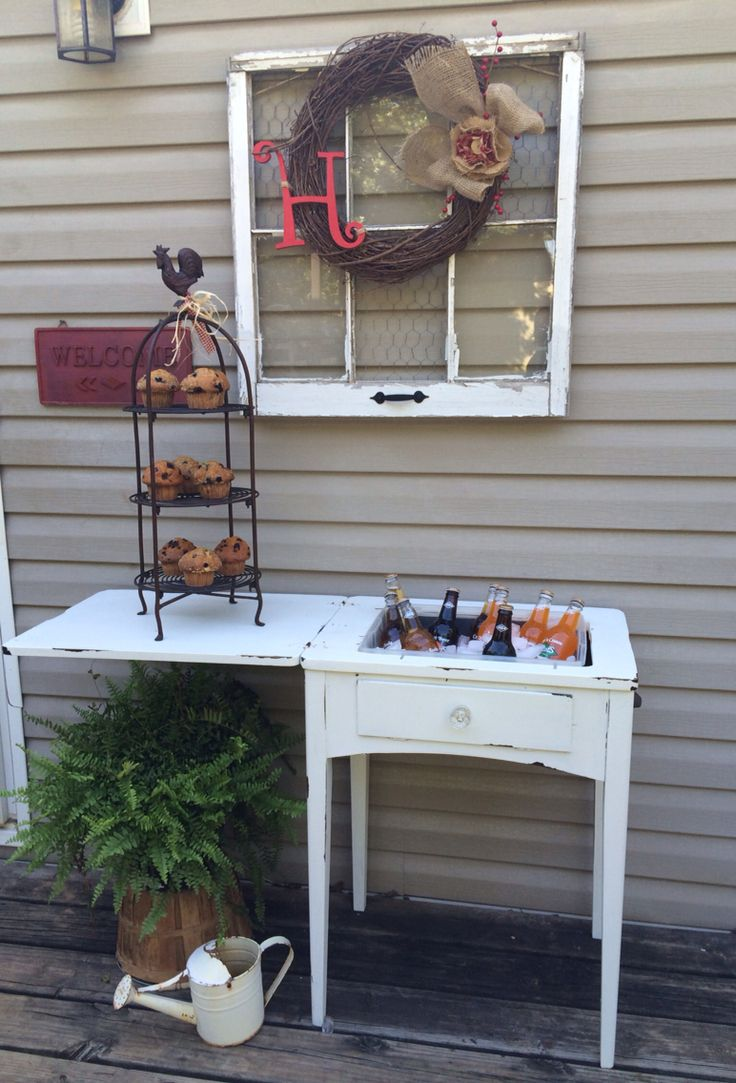 Sewing machine cabinet repurposed to drink station