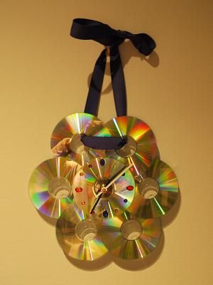 "This ""Bling Bling clock"" combines cds, a clock kit and some decorative gem stones."