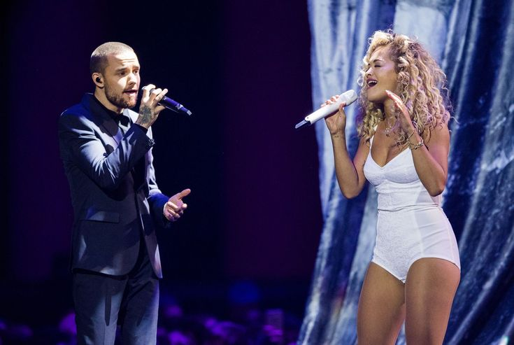 "Previous Brit duets have seen Kylie Minogue and Justin Timberlake cover Blondie's ""Rapture"" (2003), Brandon Flowers and Lady Gaga perform the Pet Shop Boys' ""West End Girls"" with Neil Tennant and Chris Lowe (2009), and Amy Winehouse belt out ""Valerie"" with Mark Ronson (2008). For 2018, Rita Ora sung ""For You"", her [i]Fifty Shades[/i] duet with Liam Payne. Ora in a confusing white body, Payne in a full suit. Talk about that for perspective."