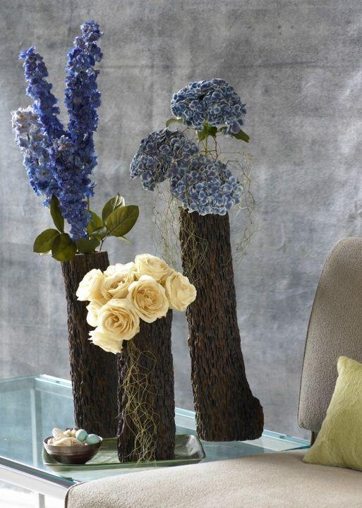 A contemporary trio in a NYC loft includes delphinium, roses & hydrangea. — Barbra Scott