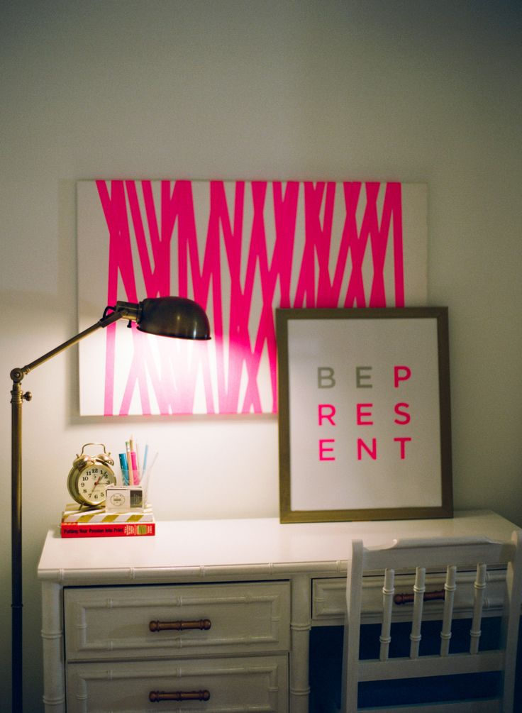 Home office with neon pink accents