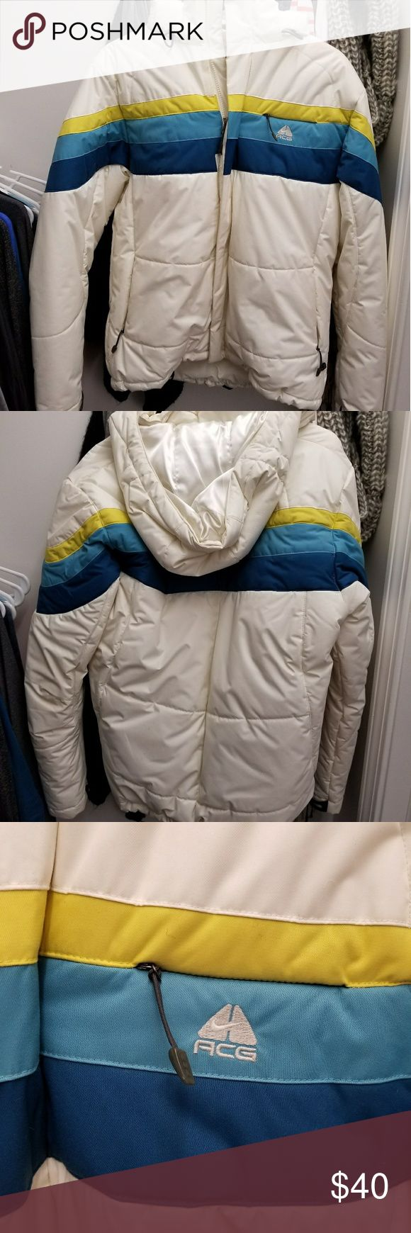 Nike Winter Coat Like New Like New winter Nike coat!!! White blues and yellow colors. Size Large in excellent condition! Only worn maybe twice. Nike Jackets & Coats Puffers
