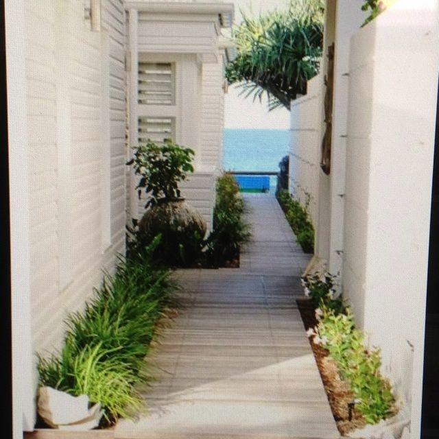 Modern Houses — beach house boardwalk entry.