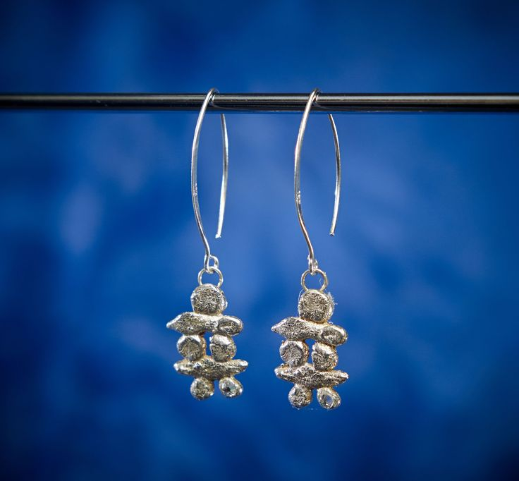 Sterling silver with a little Swarovski diamante for a bit of twinkle these Long Inukshuk Earrings are fun and easy  to wear. Made in Cananda