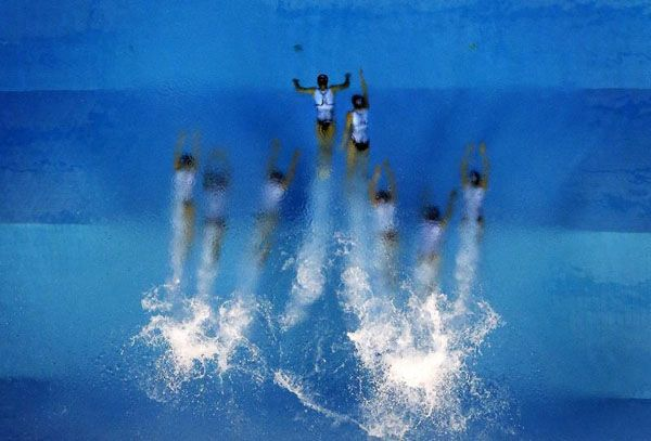 The Macau team performs during their Synchronised Swimming Free Combination routine during the 17th Asian Games in Incheon