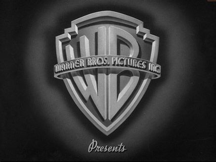 Warner Bros. logo 1941.  During 90 years the Warner Bros. shield has undergone a series of refinements. Three variations reflect transitions in ownership (Warner Bros.-Seven Arts in 1967, Kinney in 1969 and Warner Communications Inc. in 1972). (more...)