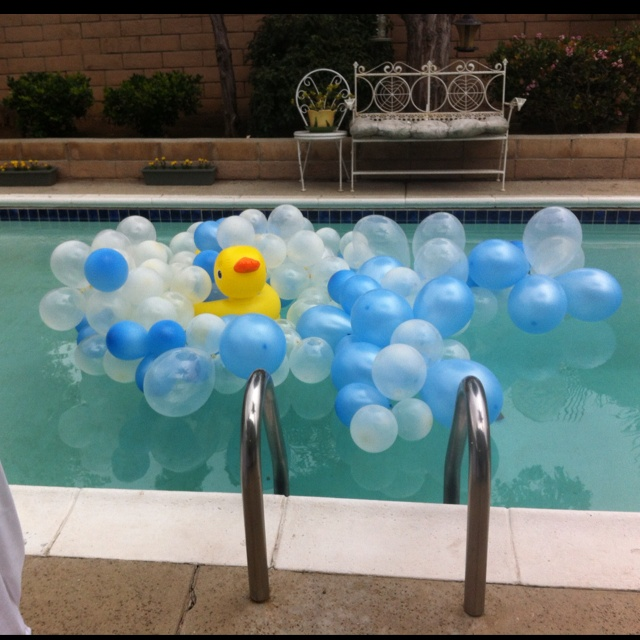 Rubber ducky Baby shower idea for the pool!  Tie balloons together with fish line, anchor the balloons to the middle of the pool by tying dumbbells to the balloons and let them sink! So cute!