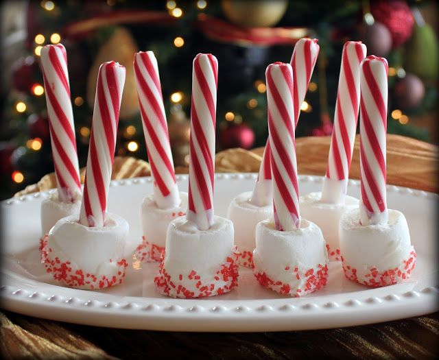 """Hot Chocolate Stirrers - """"I used white chocolate to attach the sprinkles to the marshmallow as well as the candy cane stick."""""""