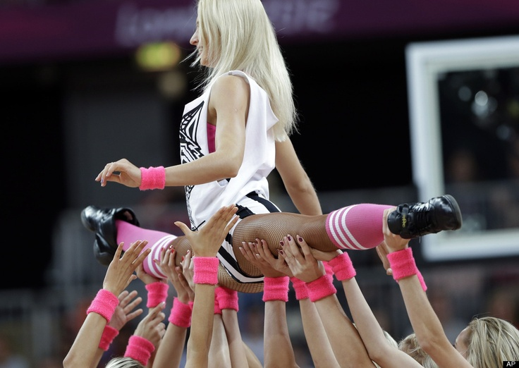 A dance team performs during a timeout of preliminary women's basketball game between Canada and Great Britain at the 2012 Summer Olympics, Monday, July 30, 2012, in London.