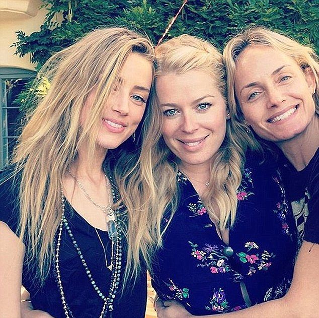 Pictured is Heard (left) at her friend Amanda de Cadenet's (centre) birthday party with Am...