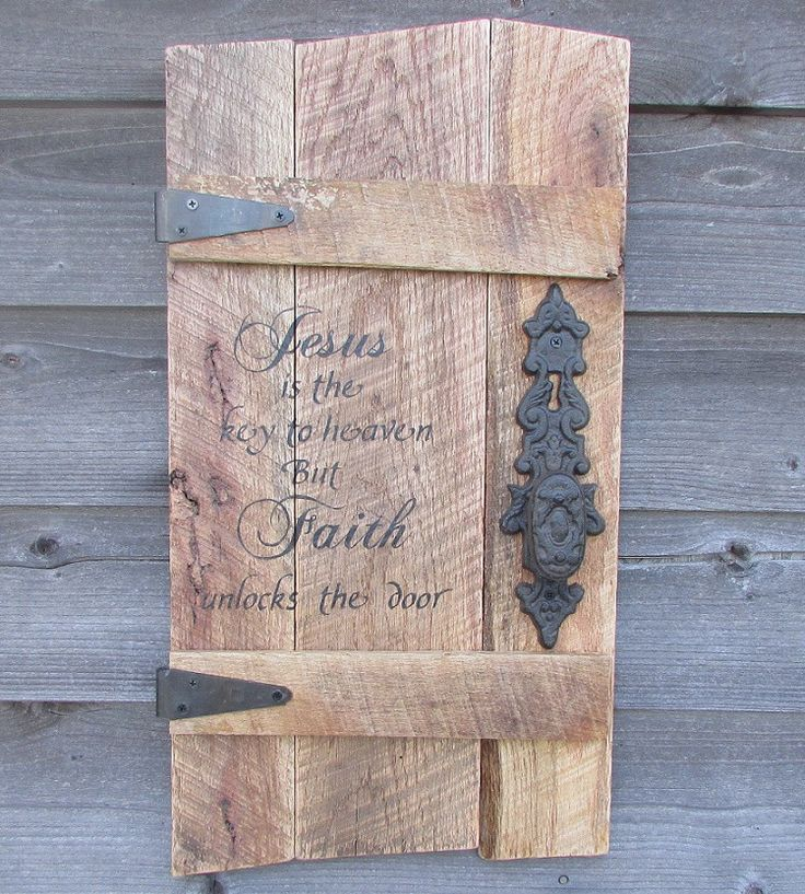 """This Primitive Rustic wood Sign is made of reclaimed pallet wood, it measures approximately 26"""" X 13"""" It is hand painted, and includes Ornate hinges and a rustic door knob. It has the scripture verse                                                                                                                                                                                  More"""