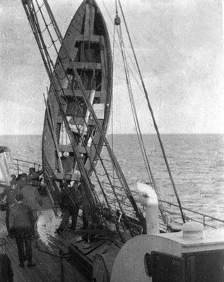 RMS Titanic lifeboat being emptied of water aboard the Carpathia.