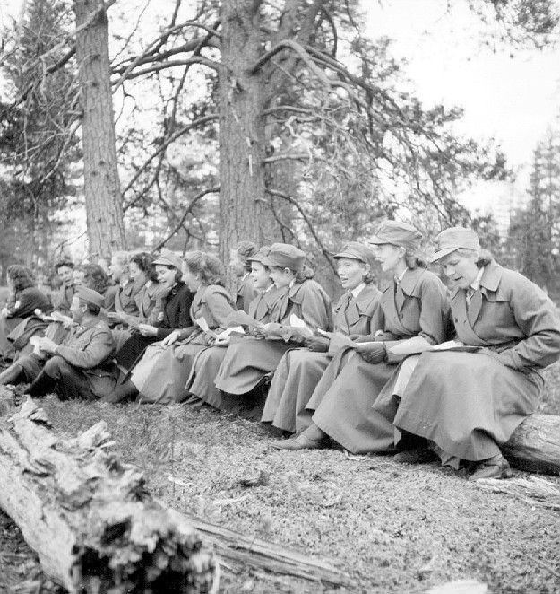 Finnish Lottas singing during Continuation War photo credit: Northern Ostrobothnia museum - Lotta Svärd was a Finnish women's voluntary military organisation which performed auxiliary defence work between 1921 and 1944.