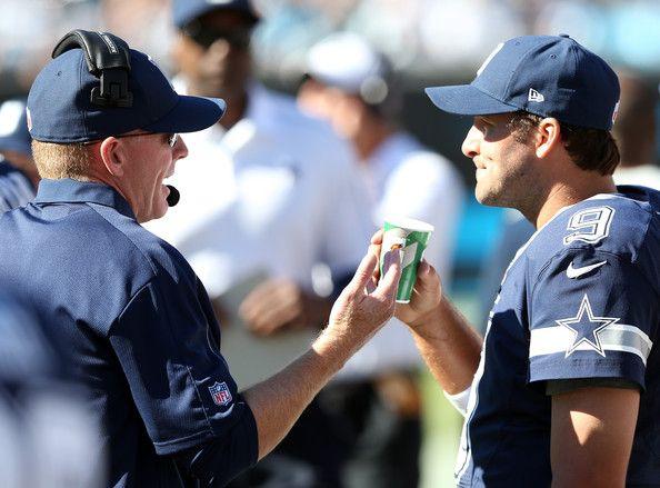 Tony Romo Photos Photos - Head coach Jason Garrett of the Dallas Cowboys talks to quarterback Tony Romo #9 during their game at Bank of America Stadium on October 21, 2012 in Charlotte, North Carolina. - Dallas Cowboys v Carolina Panthers