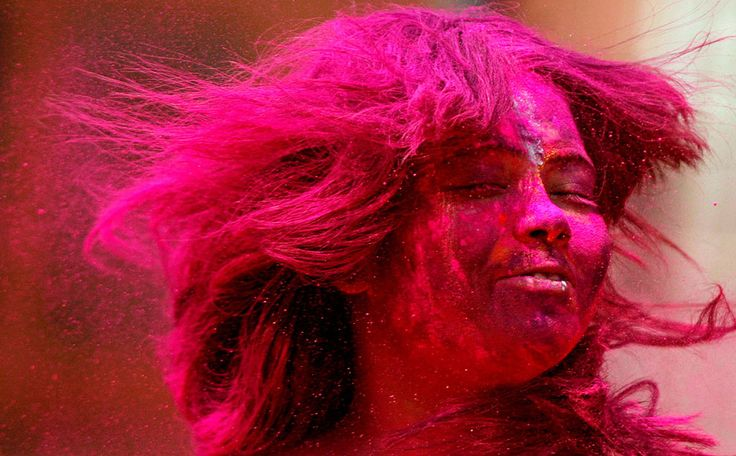 An Indian girl, her face smeared with colored powder, participates in Holi celebrations in Chennai, India, on March 8, 2012. (AP Photo/Arun Sankar K.) #