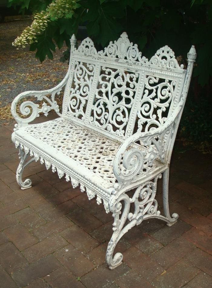 CURTAIN BENCH OR SETTEE, CAST IRON, DATED 1891