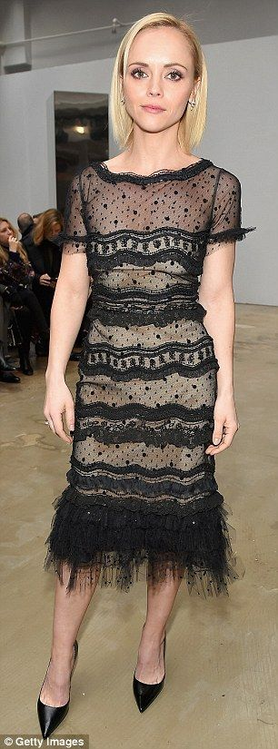 So chic: Gone Girl actress Christina, 37, wore a black lace frock with a hem adorned by ostrich feathers that she teamed with black high heels